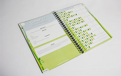 open green book finished with wire binding