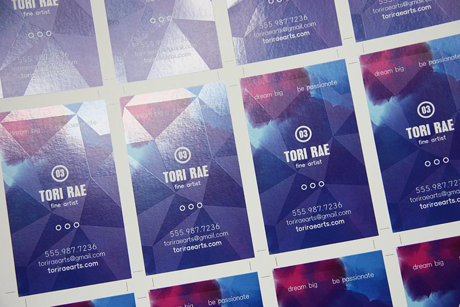A business card with iridescent effect